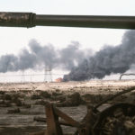 800px-Disabled_Iraqi_T-54A,_T-55,_Type_59_or_Type_69_tank_and_burning_Kuwaiti_oil_field